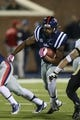 Oct 26, 2013; Oxford, MS, USA;  Mississippi Rebels running back Kailo Moore (4) advances the ball through the line during the game against the Idaho Vandals at Vaught-Hemingway Stadium. Mississippi Rebels win the game against the Idaho Vandals with a score of 59-14.  Mandatory Credit: Spruce Derden-USA TODAY Sports