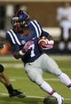Oct 26, 2013; Oxford, MS, USA;  Mississippi Rebels running back Mark Dodson (7) advances the ball against the Idaho Vandals during the game at Vaught-Hemingway Stadium. Mississippi Rebels win the game against the Idaho Vandals with a score of 59-14.  Mandatory Credit: Spruce Derden-USA TODAY Sports