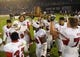 Oct 26, 2013; San Diego, CA, USA; Fresno State Bulldogs players celebrate with The Old Oil Can traveling trophy following a 35-28 overtime win against the San Diego State Aztecs at Qualcomm Stadium. Mandatory Credit: Christopher Hanewinckel-USA TODAY Sports