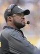 Oct 20, 2013; Pittsburgh, PA, USA; Pittsburgh Steelers head coach Mike Tomlin looks on from the sidelines against the Baltimore Ravens during the first quarter at Heinz Field. The Steelers won 19-16. Mandatory Credit: Charles LeClaire-USA TODAY Sports