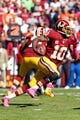 Oct 20, 2013; Landover, MD, USA; Washington Redskins quarterback Robert Griffin III (10) runs with the ball against the Chicago Bears at FedEx Field. Mandatory Credit: Geoff Burke-USA TODAY Sports