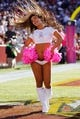 Oct 20, 2013; Landover, MD, USA; A Washington Redskins cheerleader dances on the field against the Chicago Bears at FedEx Field. Mandatory Credit: Geoff Burke-USA TODAY Sports