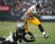 Oct 27, 2013; Oakland, CA, USA; Pittsburgh Steelers tight end Heath Miller (83) breaks a tackle during the fourth quarter against the Oakland Raiders at O.co Coliseum. The Oakland Raiders defeated the Pittsburgh Steelers 21-18. Mandatory Credit: Ed Szczepanski-USA TODAY Sports