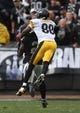 Oct 27, 2013; Oakland, CA, USA; Oakland Raiders cornerback Mike Jenkins (21) intercepts the pass intended for Pittsburgh Steelers wide receiver Emmanuel Sanders (88) during the fourth quarter at O.co Coliseum. The Oakland Raiders defeated the Pittsburgh Steelers 21-18. Mandatory Credit: Kelley L Cox-USA TODAY Sports