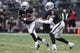 Oct 27, 2013; Oakland, CA, USA; Oakland Raiders quarterback Terrelle Pryor (2) hands off the ball to running back Darren McFadden (20) during the fourth quarter at O.co Coliseum. The Oakland Raiders defeated the Pittsburgh Steelers 21-18. Mandatory Credit: Kelley L Cox-USA TODAY Sports