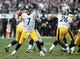 Oct 27, 2013; Oakland, CA, USA; Pittsburgh Steelers quarterback Ben Roethlisberger (7) throws a pass against the Oakland Raiders during the first quarter at O.co Coliseum. The Oakland Raiders defeated the Pittsburgh Steelers 21-18. Mandatory Credit: Ed Szczepanski-USA TODAY Sports