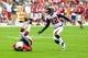 Oct 27, 2013; Phoenix, AZ, USA; Arizona Cardinals wide receiver Teddy Williams makes a 51 yard reception as Atlanta Falcons cornerback Asante Samuel (22) defends during the first half at University of Phoenix Stadium. Mandatory Credit: Matt Kartozian-USA TODAY Sports