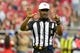 Oct 27, 2013; Phoenix, AZ, USA; NFL referee Mike Carey (94) signals during the first half of the game between the Arizona Cardinals and the Atlanta Falcons at University of Phoenix Stadium. Mandatory Credit: Matt Kartozian-USA TODAY Sports