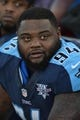 Oct 20, 2013; Nashville, TN, USA; Tennessee Titans defensive tackle Sammie Hill (94) sits in the Titans bench area in a game against the San Francisco 49ers during the second half at LP Field. The 49ers beat the Titans 31-17. Mandatory Credit: Don McPeak-USA TODAY Sports