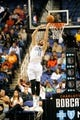 Oct 19, 2013; Greensboro, NC, USA; Charlotte Bobcats forward Josh McRoberts (11) drives to the basket and scores with a reverse dunk during the game against the Dallas Mavericks at the Greensboro Coliseum. Mavericks win 89-83. Mandatory Credit: Sam Sharpe-USA TODAY Sports
