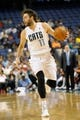 Oct 19, 2013; Greensboro, NC, USA; Charlotte Bobcats forward Josh McRoberts (11) drives down the court during the game against the Dallas Mavericks at the Greensboro Coliseum. Mavericks win 89-83. Mandatory Credit: Sam Sharpe-USA TODAY Sports