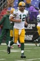 Oct 13, 2013; Baltimore, MD, USA; Green Bay Packers quarterback Aaron Rodgers (12) warms up before the game against the Baltimore Ravens at M&T Bank Stadium. Mandatory Credit: Mitch Stringer-USA TODAY Sports