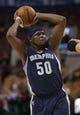 Oct 23, 2013; Toronto, Ontario, CAN; Memphis Grizzlies forward Zach Randolph (50) with the ball against the Toronto Raptors at Air Canada Centre. The Raptors beat the Grizzlies 108-72. Mandatory Credit: Tom Szczerbowski-USA TODAY Sports