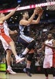 Oct 23, 2013; Toronto, Ontario, CAN; Memphis Grizzlies center Marc Gasol (33) goes to the basket to score against Toronto Raptors forward Tyler Hansbrough (50) at Air Canada Centre. The Raptors beat the Grizzlies 108-72. Mandatory Credit: Tom Szczerbowski-USA TODAY Sports