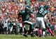 Oct 13, 2013; Tampa, FL, USA; Philadelphia Eagles quarterback Nick Foles (9) runs the ball in for a touchdown during the first quarter against the Tampa Bay Buccaneers at Raymond James Stadium. Mandatory Credit: Kim Klement-USA TODAY Sports