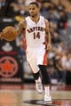 Oct 23, 2013; Toronto, Ontario, CAN; Toronto Raptors point guard D.J. Augustin (14) brings the ball up the court against the Memphis Grizzlies at Air Canada Centre. The Raptors beat the Grizzlies 108-72. Mandatory Credit: Tom Szczerbowski-USA TODAY Sports
