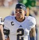 Oct 26, 2013; Colorado Springs, CO, USA; Notre Dame Fighting Irish cornerback Bennett Jackson (2) talks with teammates on the bench during the game against the Air Force Falcons at Falcon Stadium. Notre Dame won 45-10. Mandatory Credit: Matt Cashore-USA TODAY Sports