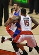 Oct 11, 2013; Toronto, Ontario, CAN; New York Knicks forward Andrea Bargnani (77) is fouled as he goes to the basket against Toronto Raptors guard DeMar DeRozan (10) and center Amir Johnson (15) at Air Canada Centre. The Raptors beat the Knicks 100-91. Mandatory Credit: Tom Szczerbowski-USA TODAY Sports