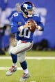Oct 21, 2013; East Rutherford, NJ, USA; New York Giants quarterback Eli Manning (10) scrambles against the Minnesota Vikings at MetLife Stadium. The Giants won the game 23-7. Mandatory Credit: Joe Camporeale-USA TODAY Sports