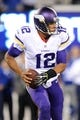 Oct 21, 2013; East Rutherford, NJ, USA; Minnesota Vikings quarterback Josh Freeman (12) scrambles against the New York Giants at MetLife Stadium. The Giants won the game 23-7. Mandatory Credit: Joe Camporeale-USA TODAY Sports
