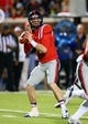 Oct 19, 2013; Oxford, MS, USA; Mississippi Rebels quarterback Bo Wallace (14) drops back to pass the ball during the game against the LSU Tigers at Vaught-Hemingway Stadium. Mississippi Rebels defeat the LSU Tigers 27-24.  Mandatory Credit: Spruce Derden-USA TODAY Sports