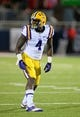 Oct 19, 2013; Oxford, MS, USA; LSU Tigers running back Alfred Blue (4) during the game against the Mississippi Rebels at Vaught-Hemingway Stadium. Mississippi Rebels defeat the LSU Tigers 27-24.  Mandatory Credit: Spruce Derden-USA TODAY Sports