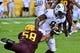 Oct 19, 2013; Tempe, AZ, USA; Washington Huskies wide receiver Kevin Smith (8) and Arizona State Sun Devils linebacker Salamo Fiso (58) during the game at Sun Devil Stadium. Mandatory Credit: Matt Kartozian-USA TODAY Sports