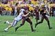 Oct 19, 2013; Tempe, AZ, USA; Arizona State Sun Devils running back Marion Grice (1), quarterback Taylor Kelly (10) and Washington Huskies defensive end Evan Hudson (80) during the game at Sun Devil Stadium. Mandatory Credit: Matt Kartozian-USA TODAY Sports