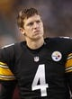 Oct 20, 2013; Pittsburgh, PA, USA; Pittsburgh Steelers punter Zoltan Mesko (4) looks on from the sidelines against the Baltimore Ravens during the third quarter at Heinz Field. The Steelers won 19-16. Mandatory Credit: Charles LeClaire-USA TODAY Sports