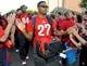 Oct 19, 2013; Tucson, AZ, USA; Arizona Wildcats free safety Jamar Allah (27) gives fans high fives before the first quarter against the Utah Utes at Arizona Stadium. Arizona beat Utah 35-44. Mandatory Credit: Casey Sapio-USA TODAY Sports