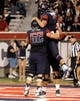 Oct 19, 2013; Tucson, AZ, USA; Arizona Wildcats offensive lineman Chris Putton (62) congratulates quarterback B.J. Denker (7) after a successful two point conversion during the fourth quarter against the Utah Utes at Arizona Stadium. Arizona beat Utah 35-44. Mandatory Credit: Casey Sapio-USA TODAY Sports