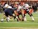 Oct 19, 2013; Tucson, AZ, USA; Utah Utes offensive lineman Vyncent Jones (64) prepares to snap the ball during the fourth quarter against the Arizona Wildcats at Arizona Stadium. Arizona beat Utah 35-44. Mandatory Credit: Casey Sapio-USA TODAY Sports