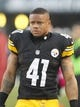 Oct 20, 2013; Pittsburgh, PA, USA; Pittsburgh Steelers cornerback Antwon Blake (41) looks on from the sidelines against the Baltimore Ravens during the third quarter at Heinz Field. The Steelers won 19-16. Mandatory Credit: Charles LeClaire-USA TODAY Sports