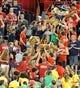 Oct 19, 2013; Tucson, AZ, USA; Arizona Wildcats fans hold up Arizona mascots Wilma and Wilbur during the third quarter against the Utah Utes at Arizona Stadium. Arizona beat Utah 35-44. Mandatory Credit: Casey Sapio-USA TODAY Sports