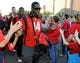 Oct 19, 2013; Tucson, AZ, USA; Arizona Wildcats safety Tellas Jones (14) gives fans high fives before the first quarter against the Utah Utes at Arizona Stadium. Arizona beat Utah 35-44. Mandatory Credit: Casey Sapio-USA TODAY Sports