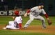 Oct 27, 2013; St. Louis, MO, USA; St. Louis Cardinals second baseman Matt Carpenter (13) slides into second base as Boston Red Sox shortstop Stephen Drew (right) waits for the ball in the third inning during game four of the MLB baseball World Series at Busch Stadium. Mandatory Credit: Scott Rovak-USA TODAY Sports