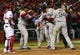 Oct 27, 2013; St. Louis, MO, USA; Boston Red Sox left fielder Jonny Gomes (second from right) is congratulated by teammates David Ortiz (34) and Dustin Pedroia (second from left) after hitting a three-run home run against the St. Louis Cardinals in the sixth inning during game four of the MLB baseball World Series at Busch Stadium. Mandatory Credit: Scott Rovak-USA TODAY Sports