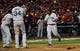 Oct 27, 2013; St. Louis, MO, USA; Boston Red Sox left fielder Jonny Gomes (right) is congratulated by teammates David Ortiz (34) and Dustin Pedroia (15) after hitting a three-run home run against the St. Louis Cardinals in the sixth inning during game four of the MLB baseball World Series at Busch Stadium. Mandatory Credit: Scott Rovak-USA TODAY Sports