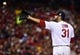 Oct 27, 2013; St. Louis, MO, USA; St. Louis Cardinals starting pitcher Lance Lynn (31) catches the ball between pitches against the Boston Red Sox during game four of the MLB baseball World Series at Busch Stadium. Mandatory Credit: Scott Rovak-USA TODAY Sports