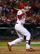 Oct 27, 2013; St. Louis, MO, USA; St. Louis Cardinals second baseman Matt Carpenter hits a RBI single against the Boston Red Sox during game four of the MLB baseball World Series at Busch Stadium. Mandatory Credit: Scott Rovak-USA TODAY Sports