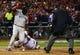 Oct 27, 2013; St. Louis, MO, USA; Boston Red Sox first baseman David Ortiz (left) scores a run past St. Louis Cardinals catcher Yadier Molina (4) during game four of the MLB baseball World Series at Busch Stadium. Mandatory Credit: Scott Rovak-USA TODAY Sports