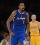 Oct 29, 2013; Los Angeles, CA, USA;  Los Angeles Clippers center DeAndre Jordan (6) reacts to a dunk as Los Angeles Lakers point guard Steve Blake (5) looks on in the second half of the game at Staples Center. Lakers won 116-103. Mandatory Credit: Jayne Kamin-Oncea-USA TODAY Sports