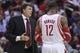 Oct 30, 2013; Houston, TX, USA; Houston Rockets head coach Kevin McHale talks to center Dwight Howard (12) during the second quarter against the Charlotte Bobcats at Toyota Center. Mandatory Credit: Troy Taormina-USA TODAY Sports