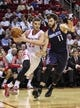 Oct 30, 2013; Houston, TX, USA; Houston Rockets small forward Chandler Parsons (25) drives to the basket during the second quarter as Charlotte Bobcats power forward Josh McRoberts (11) defends at Toyota Center. Mandatory Credit: Troy Taormina-USA TODAY Sports
