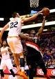 Oct 30, 2013; Phoenix, AZ, USA; Phoenix Suns center Miles Plumlee (22) blocks the shot of Portland Trail Blazers guard Wesley Matthews (2) in the first quarter at US Airways Center. Mandatory Credit: Mark J. Rebilas-USA TODAY Sports