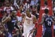 Oct 30, 2013; Houston, TX, USA; Houston Rockets center Dwight Howard (12) signals after scoring a basket during the fourth quarter against the Charlotte Bobcats at Toyota Center. Mandatory Credit: Troy Taormina-USA TODAY Sports