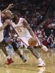 Oct 30, 2013; Houston, TX, USA; Houston Rockets shooting guard James Harden (13) drives the ball during the first quarter against the Charlotte Bobcats at Toyota Center. The Rockets defeated the Bobcats 96-83. Mandatory Credit: Troy Taormina-USA TODAY Sports
