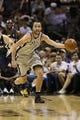 Oct 30, 2013; San Antonio, TX, USA; San Antonio Spurs guard Manu Ginobili (20) starts a fast break against the Memphis Grizzlies during the second half at AT&T Center. The Spurs won 101-94. Mandatory Credit: Soobum Im-USA TODAY Sports