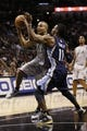 Oct 30, 2013; San Antonio, TX, USA; San Antonio Spurs guard Tony Parker (9) drives to the basket as Memphis Grizzlies guard Mike Conley (11) defends during the second half at AT&T Center. The Spurs won 101-94. Mandatory Credit: Soobum Im-USA TODAY Sports
