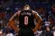 Oct 30, 2013; Phoenix, AZ, USA; Portland Trail Blazers guard Damian Lillard reacts in the fourth quarter against the Phoenix Suns at US Airways Center. The Suns defeated the Blazers 104-91. Mandatory Credit: Mark J. Rebilas-USA TODAY Sports